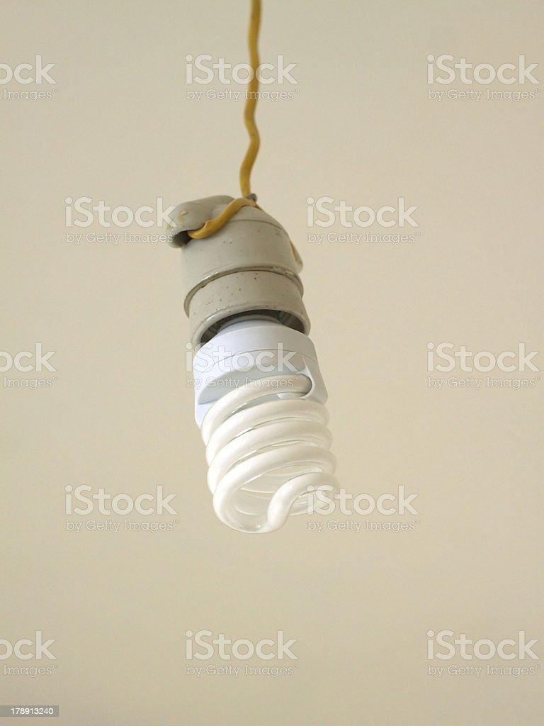 Energy saving bulb hangs closeup royalty-free stock photo