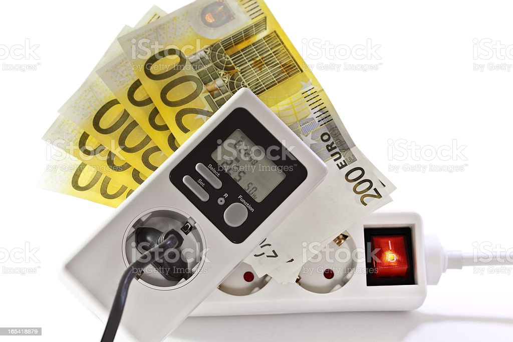 Energy saving- current meter with european notes stock photo
