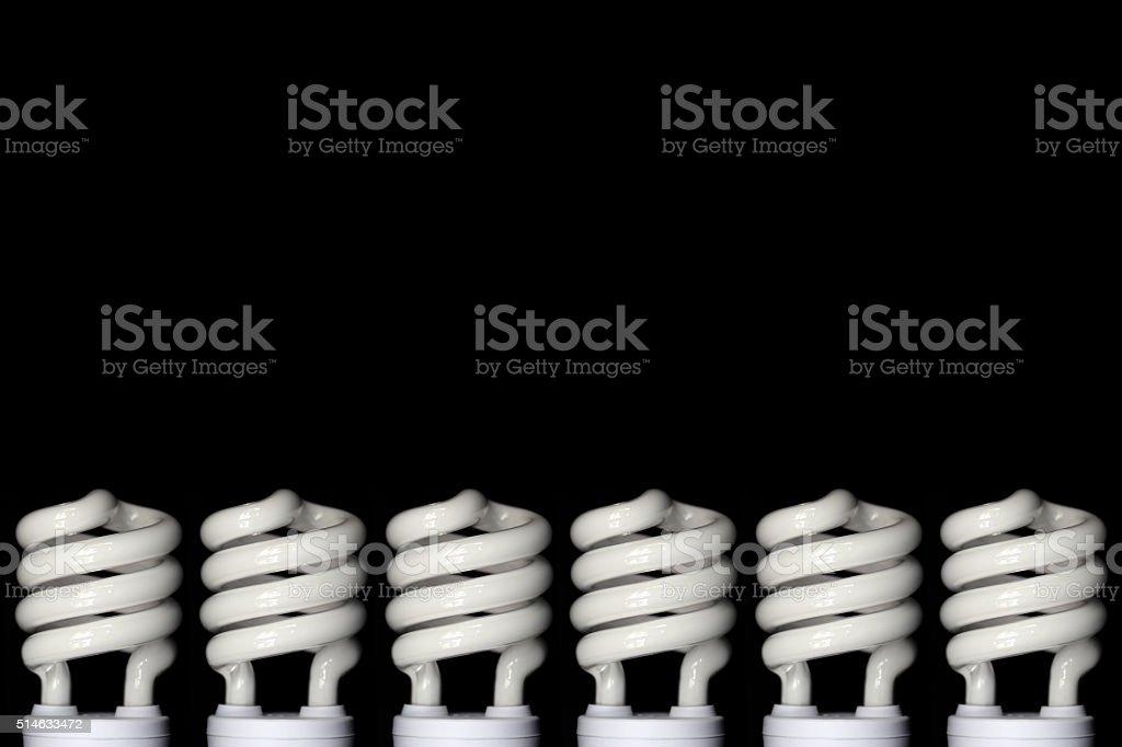 Energy saving fluorescent light bulb on Black background stock photo