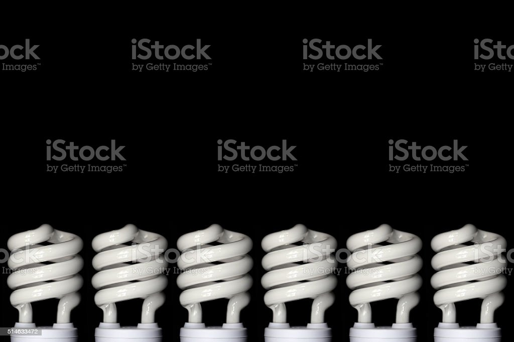 Energy saving fluorescent light bulb on Black background stock photo