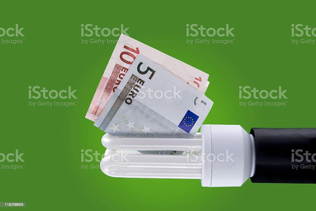 Energy saving lamp - euro banknotes royalty-free stock photo