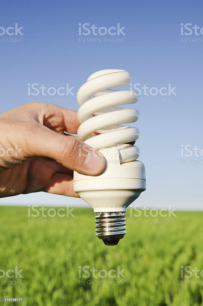 energy saving lamp in hand stock photo