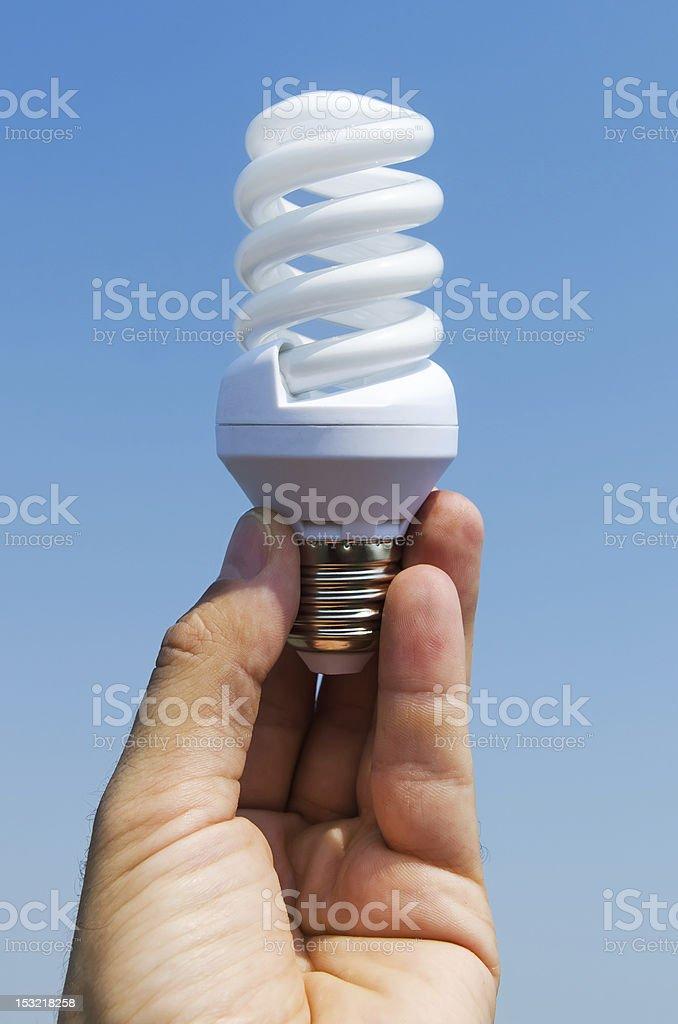 energy saving lamp in hand royalty-free stock photo