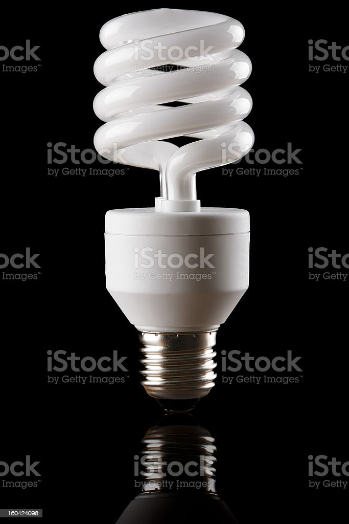 energy saving lamp with your own reflection royalty-free stock photo