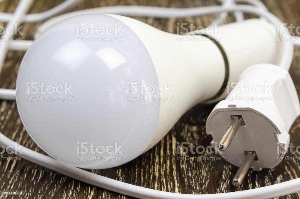 energy saving led light bulb on wooden background. stock photo