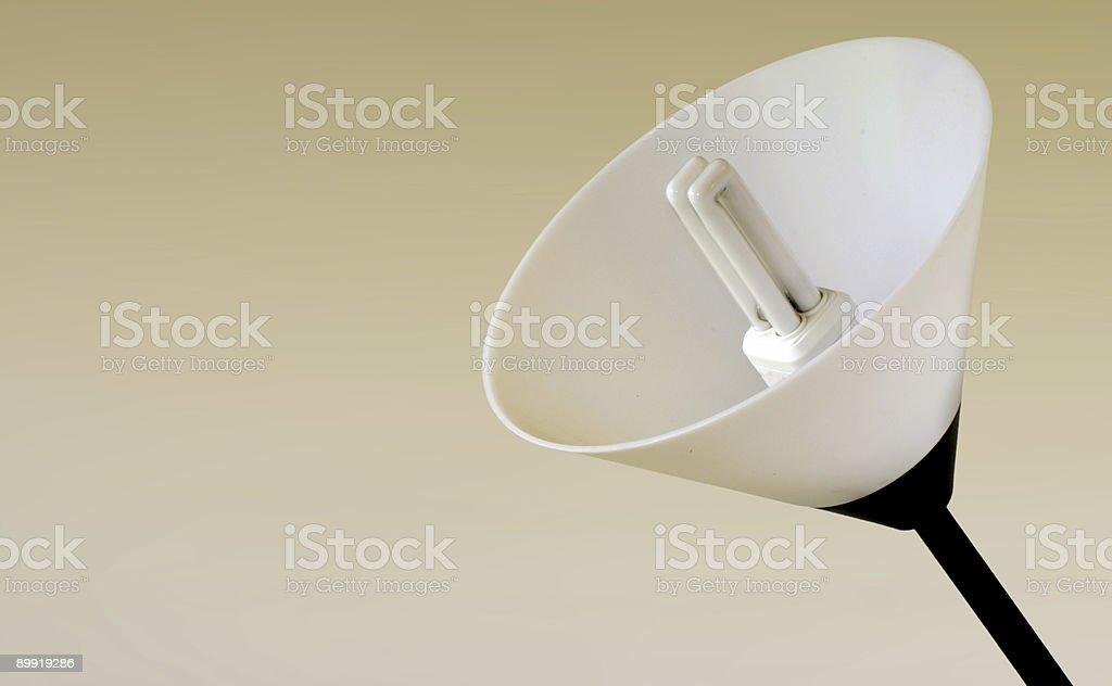 Energy saving light bulb and lamp shade stock photo