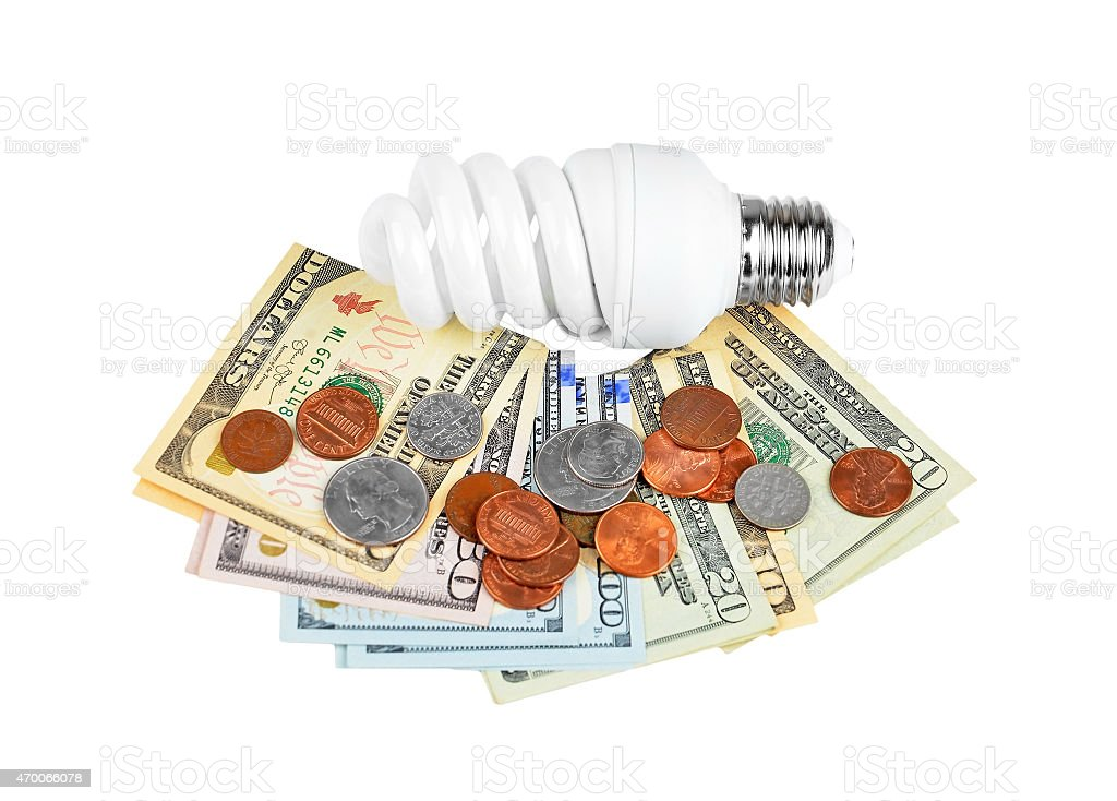 Energy saving light bulb and money stock photo