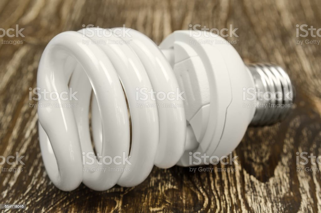 energy saving light bulb on wooden background stock photo