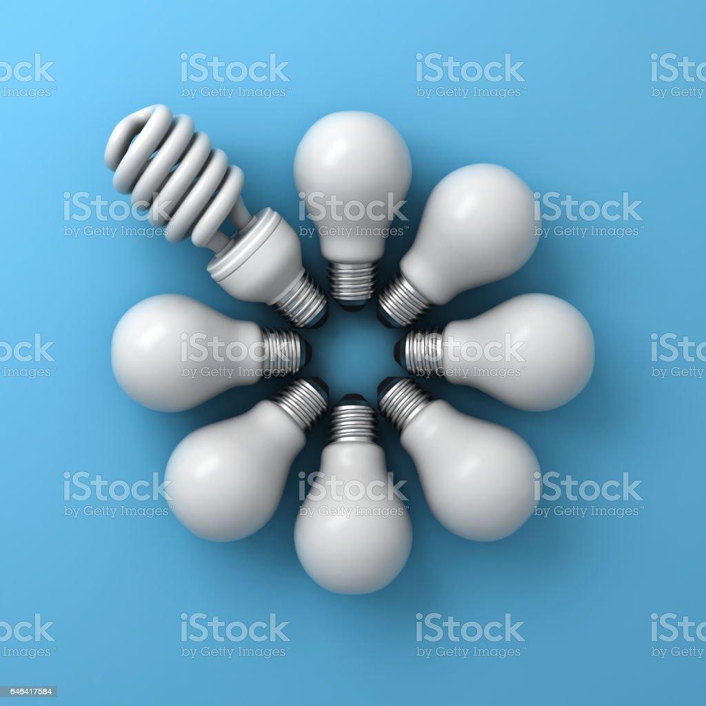 Energy saving light bulb , one compact fluorescent lightbulb among incandescent bulbs on blue background stock photo
