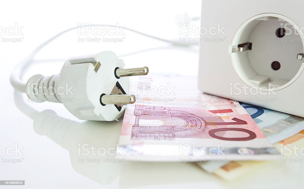Energy saving, plug, outlet and european notes stock photo