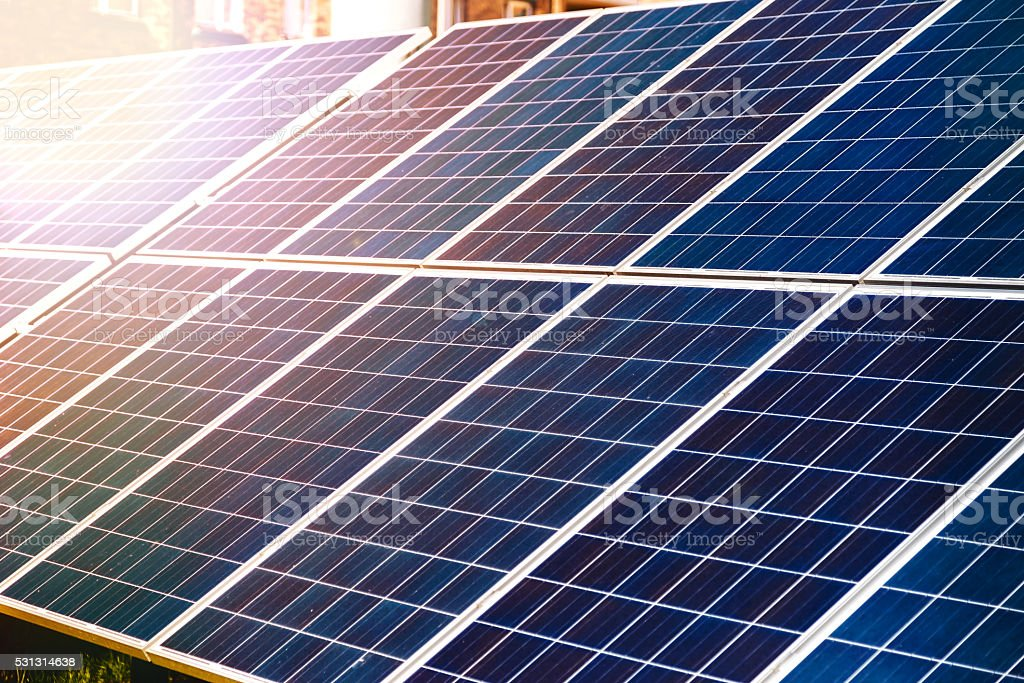Energy-efficient solar panels producing electricity stock photo