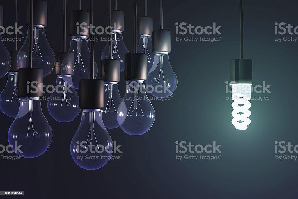energy-saving lamp among the gray bulb stock photo
