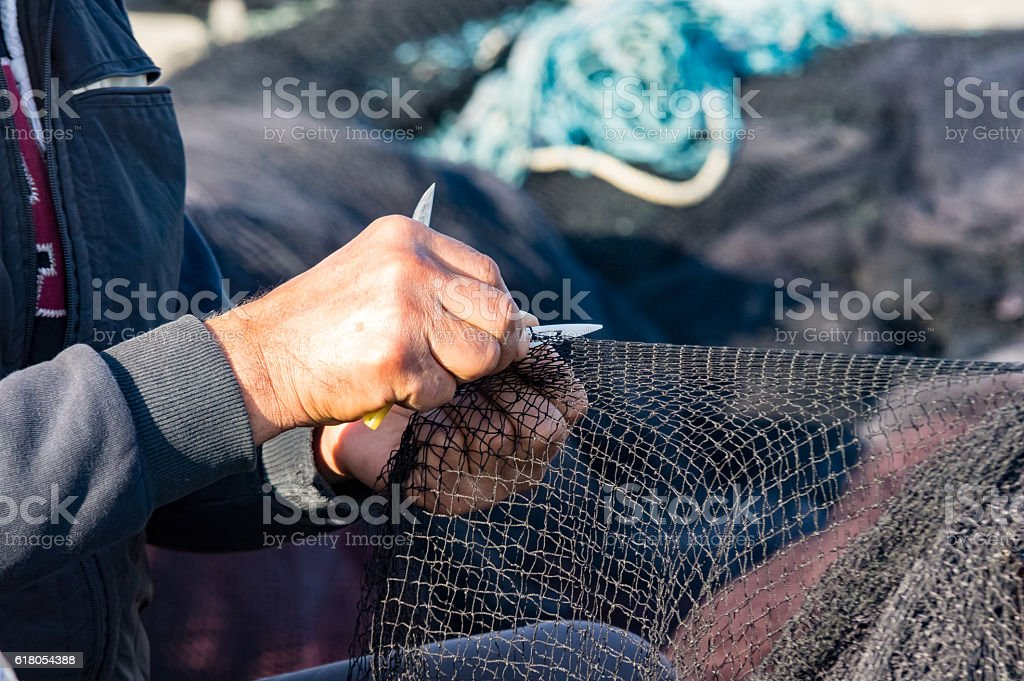 engaged in fishing net stock photo