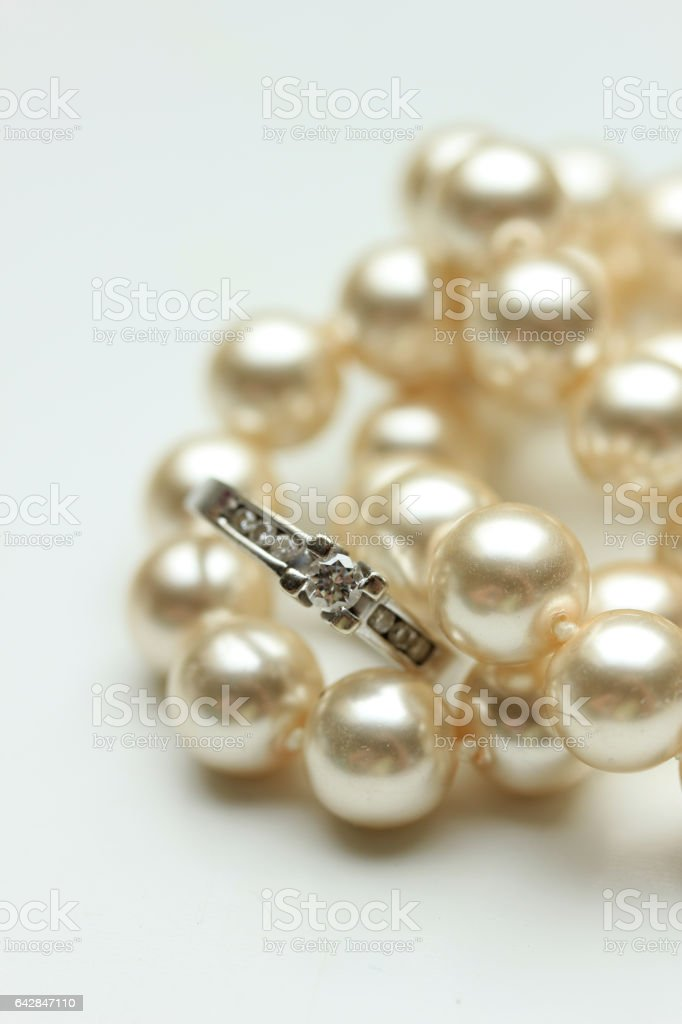 Engagement ring on pearls stock photo