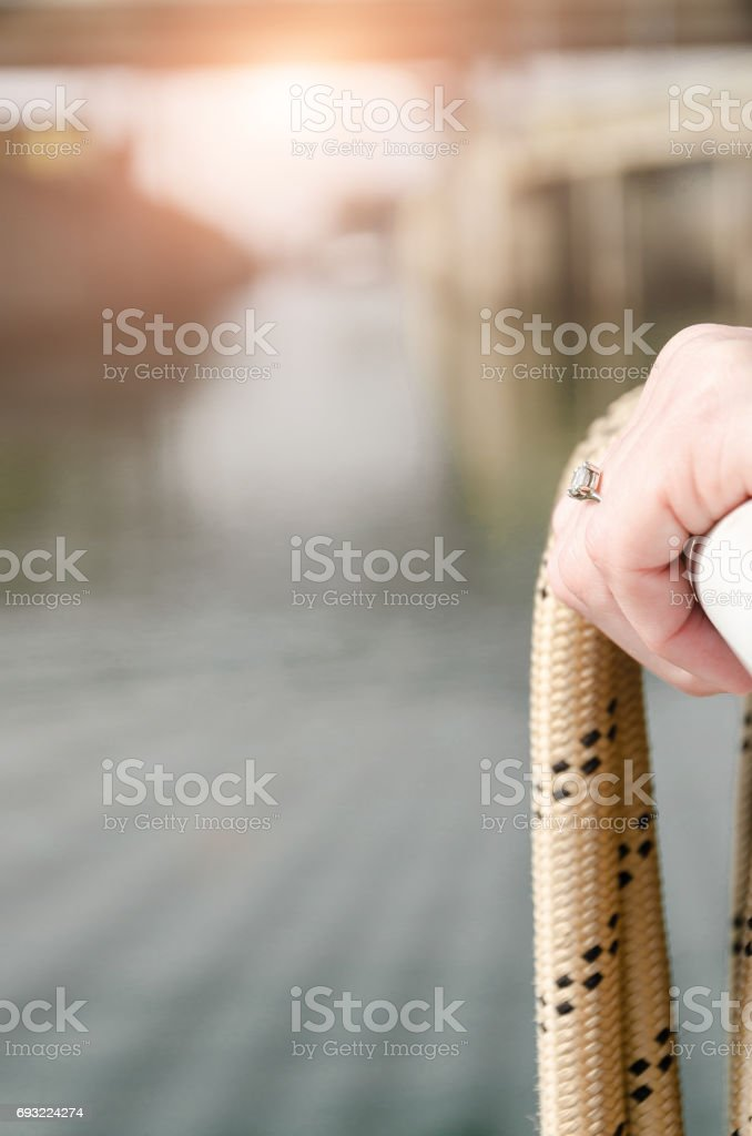 engagement ring on woman's hand, relaxation and enjoyment on the boat stock photo