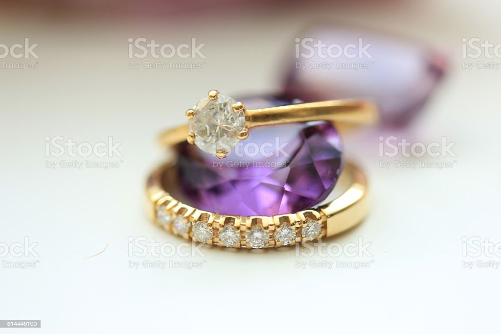 Engagement rings and Amethyst stock photo
