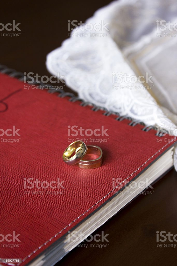 engagement rings standing on red notebook stock photo
