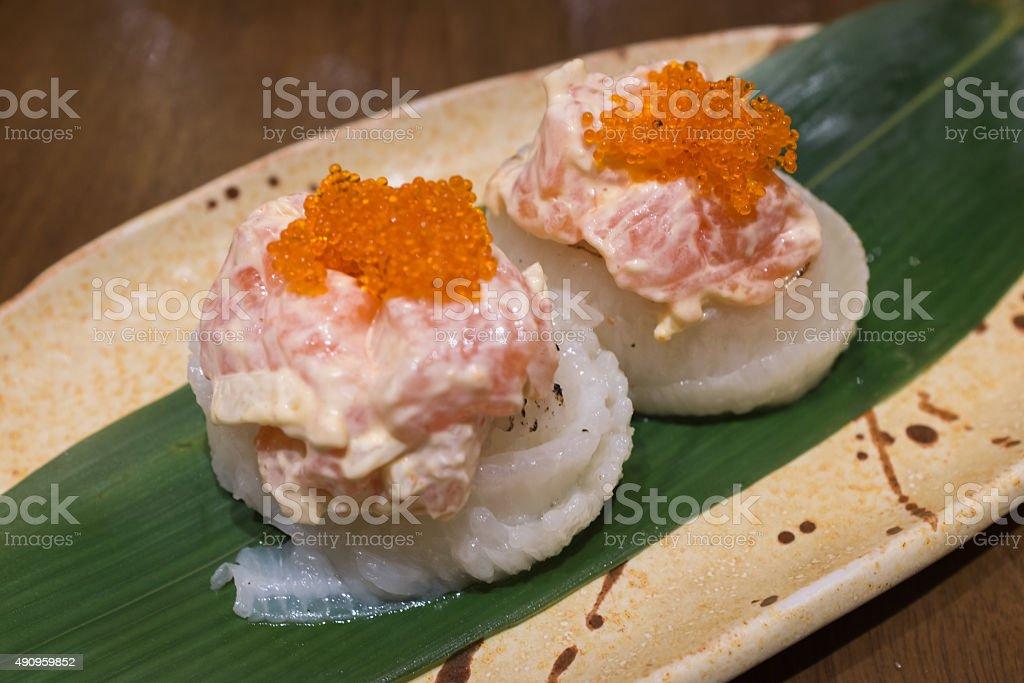 Engawa roll with salmon salad on top stock photo