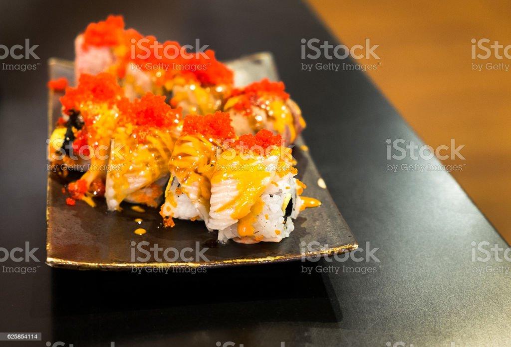 Engawa sushi set on black plate stock photo