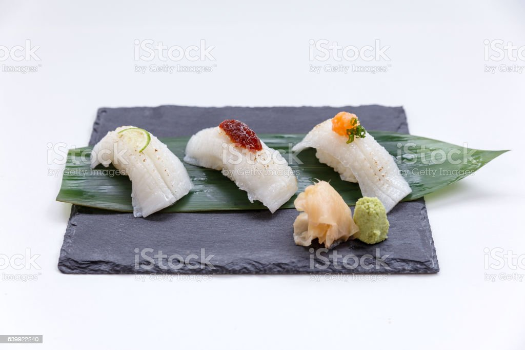 Engawa Sushi Topping with Lime, Chilli Jam and Minced Daikon. stock photo