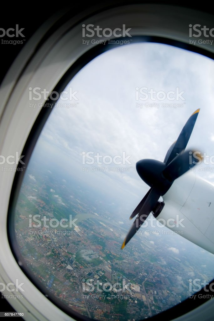 engine and propeller of the plane, view from window airplane stock photo