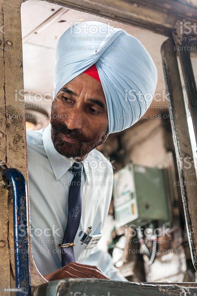 Engine Driver in Disel Locomotive Shimla Railway Station ,India stock photo