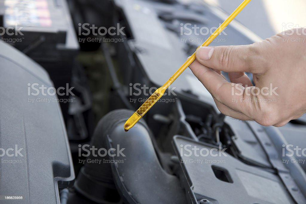 engine oil dipstick stock photo