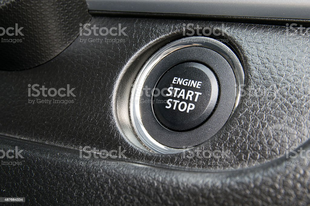 Engine start stop button from a modern car interior stock photo