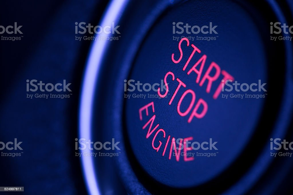 Engine start stop button in the car stock photo