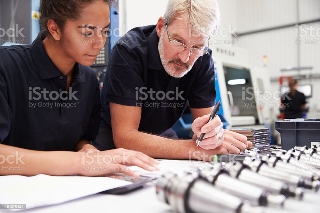 Engineer And Apprentice Planning CNC Machinery Project stock photo