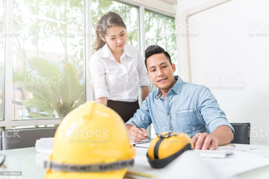 Engineer and architect discussing at working table stock photo