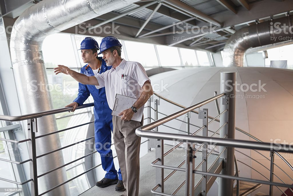 Engineer and builder at construction site stock photo