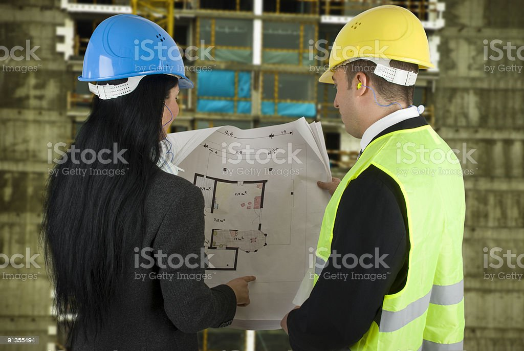 Engineer and buyer with project on site royalty-free stock photo