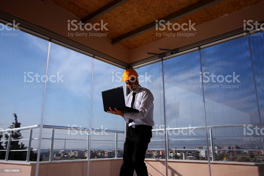 Engineer and Laptop stock photo