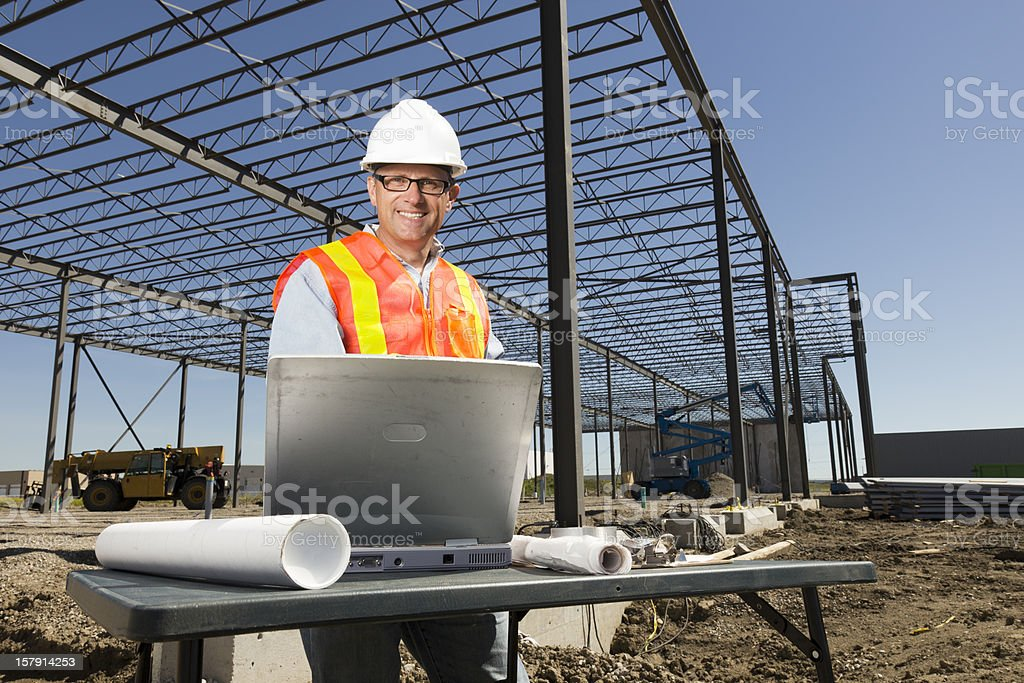 Engineer and Plans royalty-free stock photo