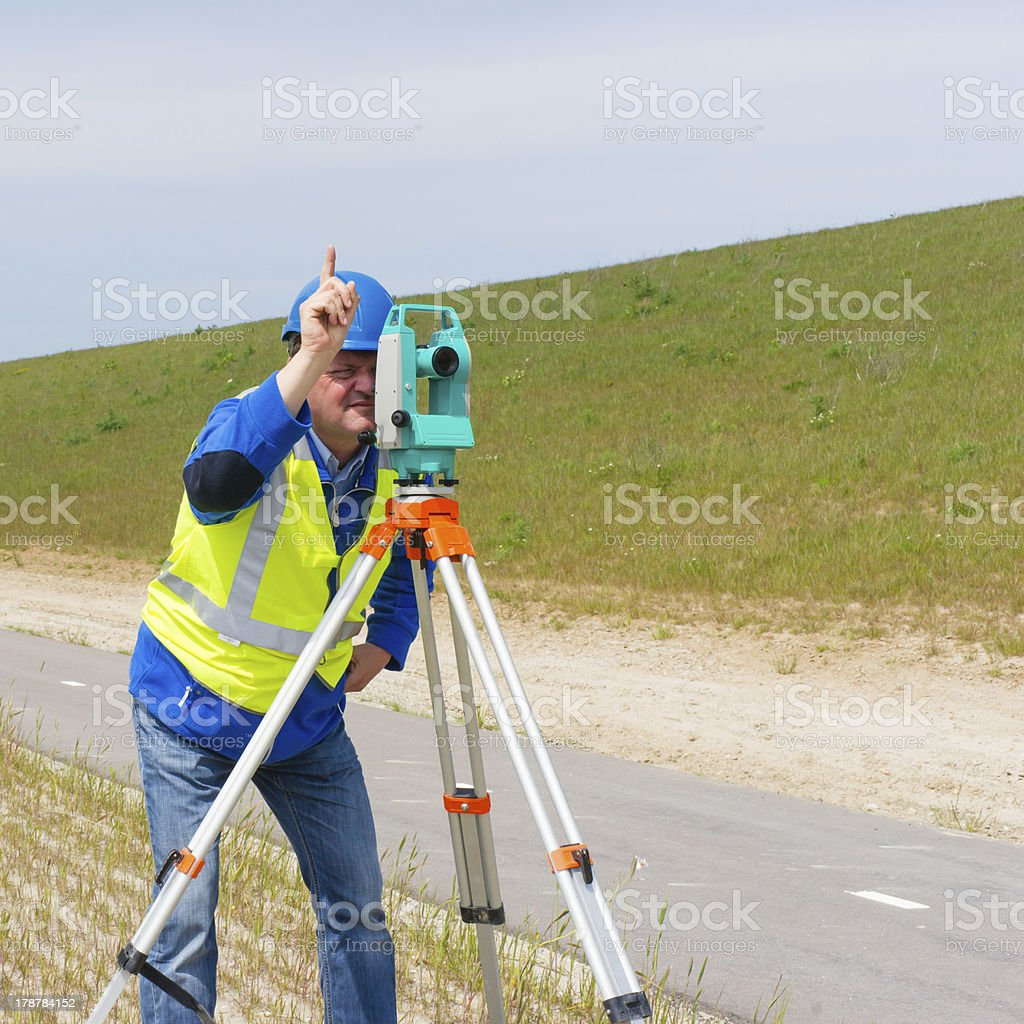 Engineer and Total station or theodolite royalty-free stock photo