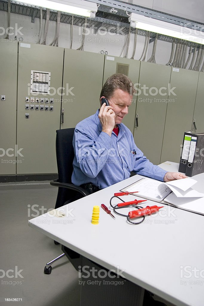 Engineer at the Phone royalty-free stock photo