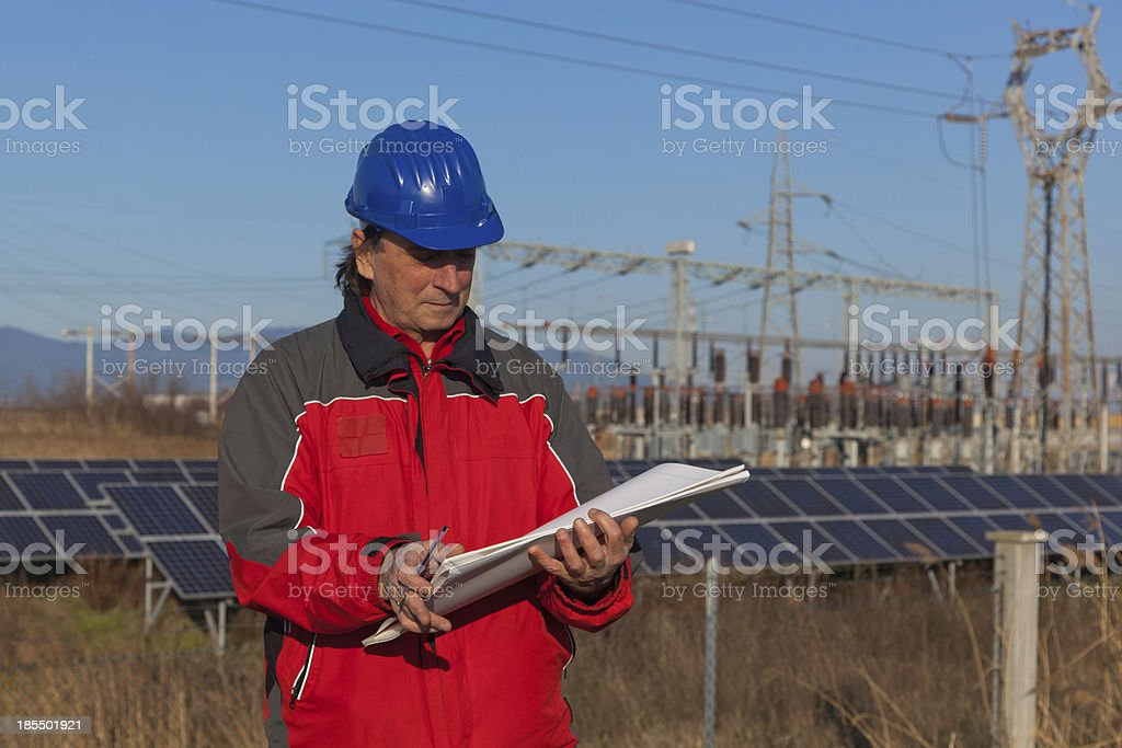 Engineer at Work In a Solar Power Station royalty-free stock photo