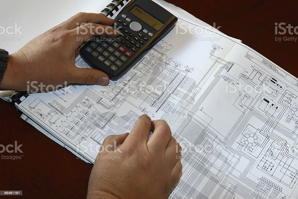 Engineer calculating on diagram stock photo