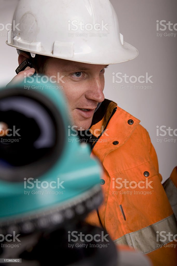 Engineer calling in case of land measurement royalty-free stock photo
