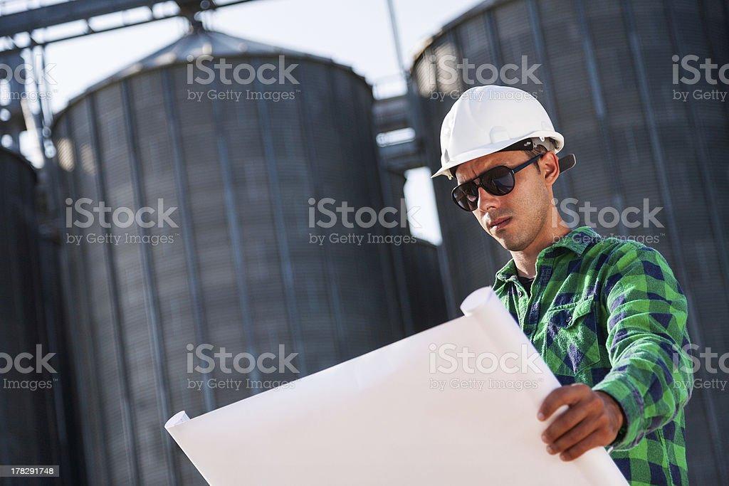 Engineer checking blueprints royalty-free stock photo