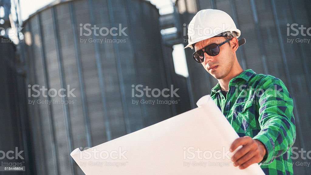 Engineer checking blueprints stock photo