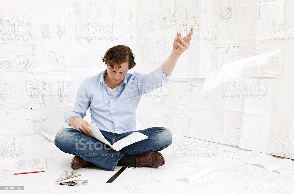 Engineer checking drawings royalty-free stock photo