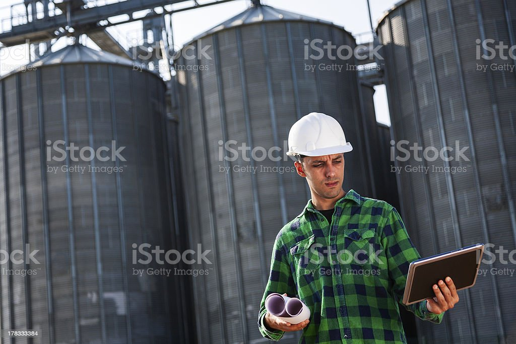 Engineer checking his digital tablet royalty-free stock photo
