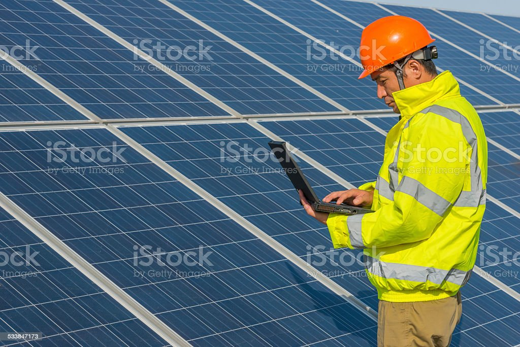 Engineer checking notebook at soalr panel stock photo