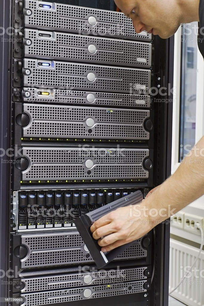 IT Engineer Checks Disk Cabinet royalty-free stock photo