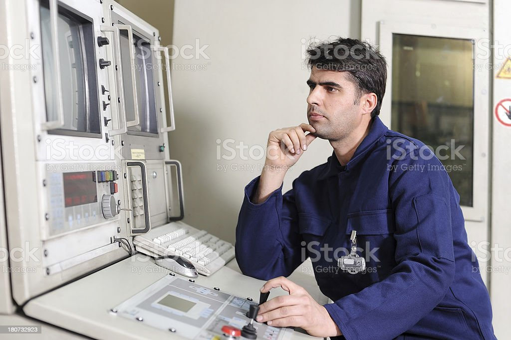 Engineer controlling factory production royalty-free stock photo