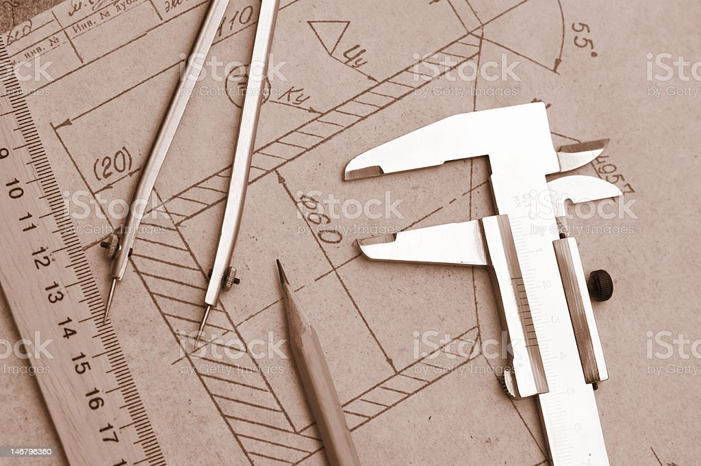 Engineer drawing and pencil, trammel, compasses.Sepia tone. royalty-free stock photo