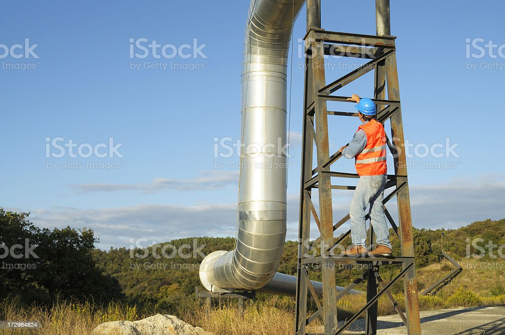Engineer examining pipe royalty-free stock photo