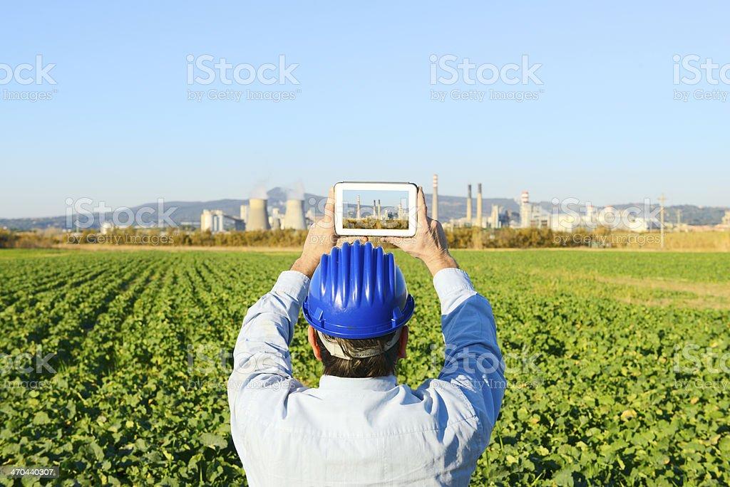 Engineer Filming Refinery stock photo